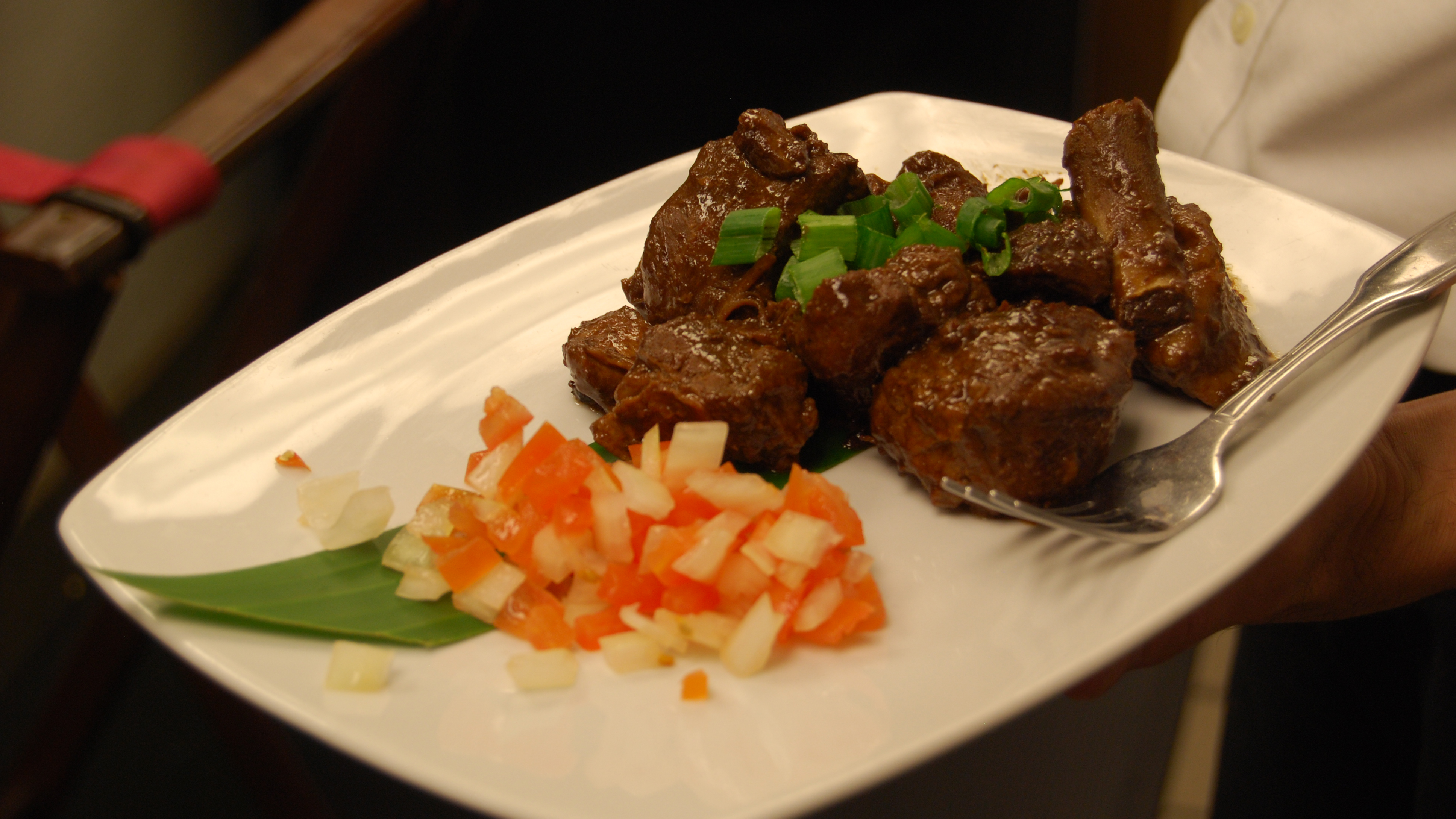 Max's Pinatuyong Pork Adobo, braised and spiced and using cooking methods popular in the Philippines. Max's has been serving food in the Philippines since 1945.