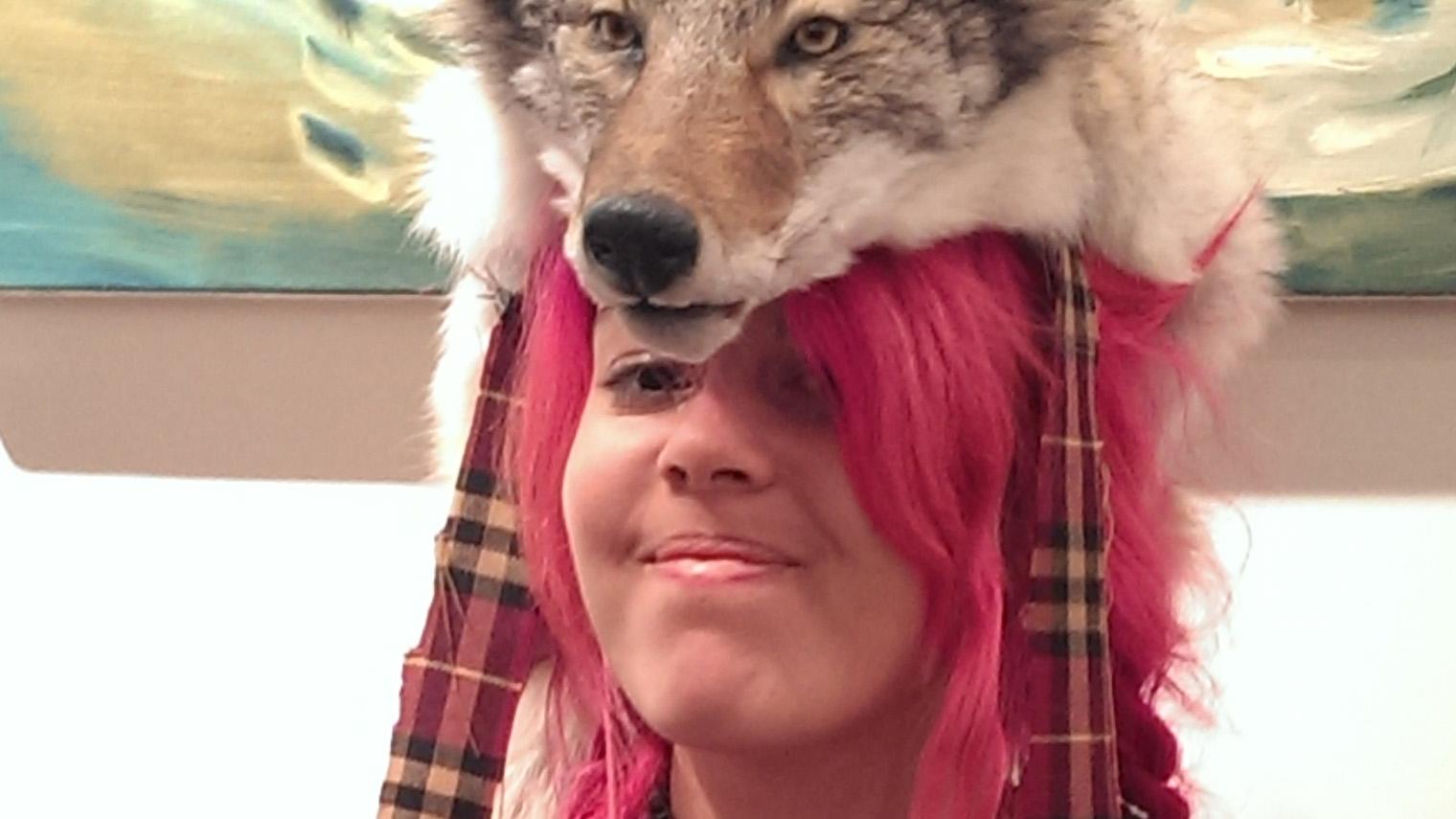 Laetitia Barbier, head librarian at Morbid Anatomy, wearing a wolf pelt at Krampusfest.