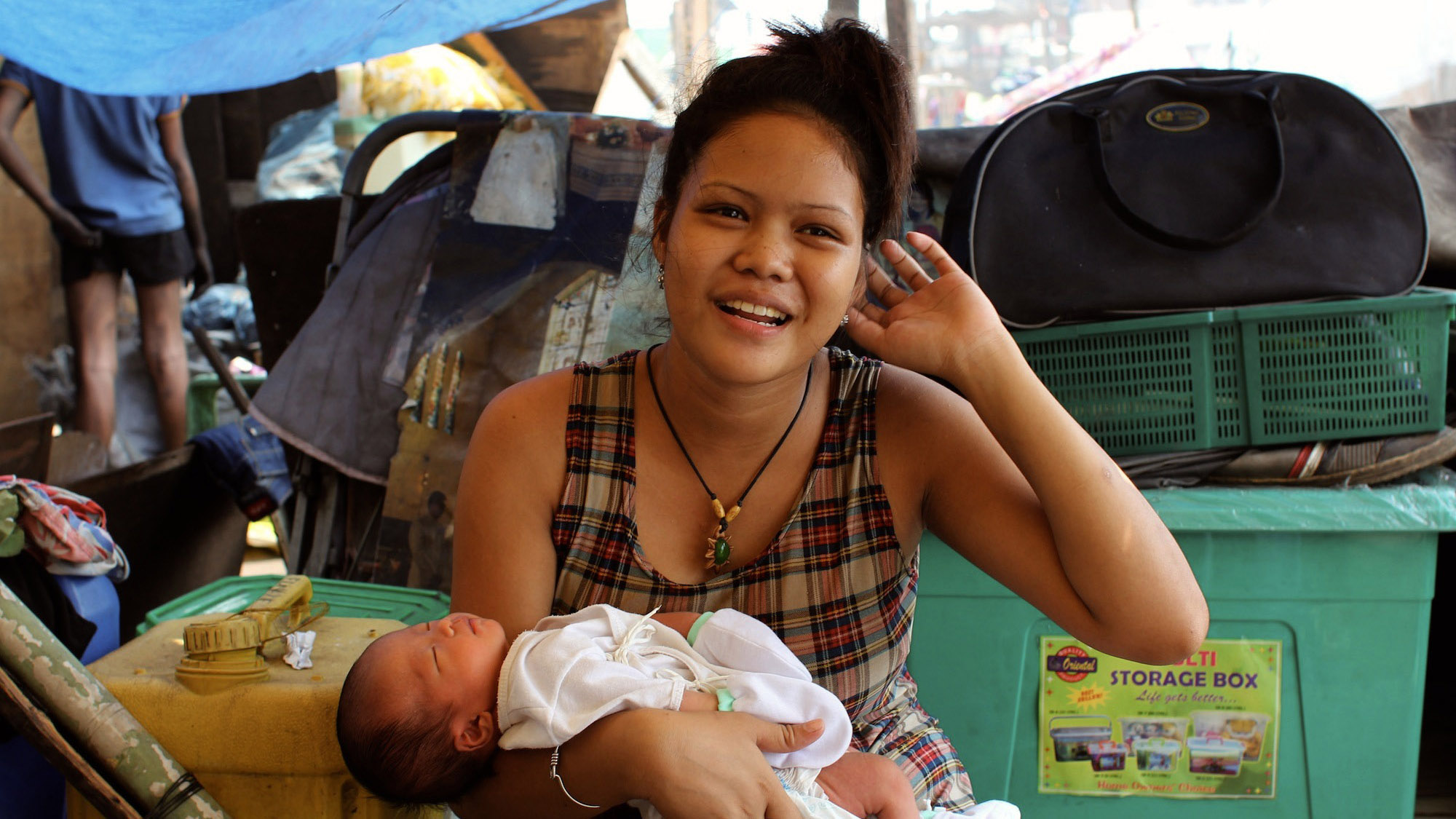 Ana Lisa Loste's daughter, Elisa, 17, holds her six-day-old infant, John Bird Fajardo. This is her second son after her eldest died of heart failure when he was twelve days old.