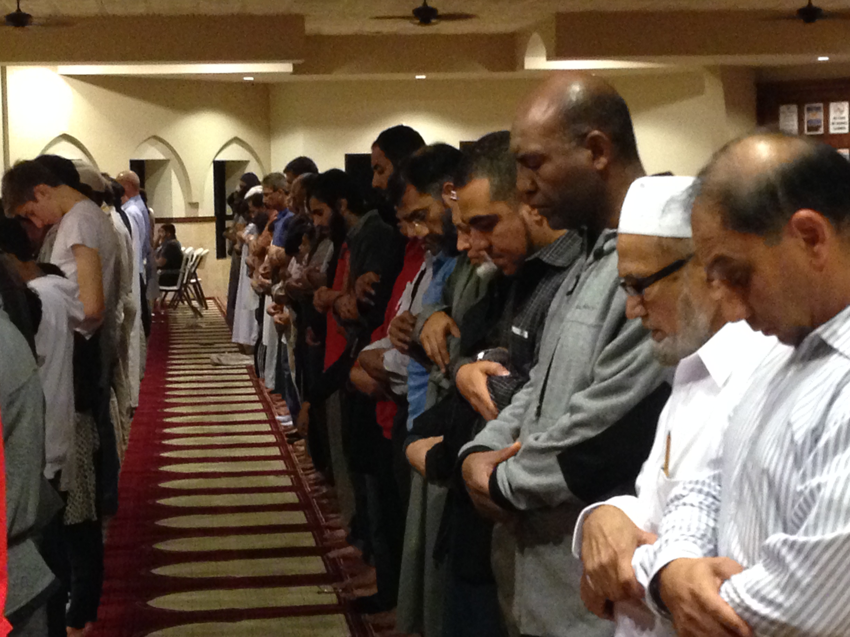 Evening prayers at the Maryam Mosque in Sugar Land Texas. Jaime Mujahid Fletcher is fourth from the right.