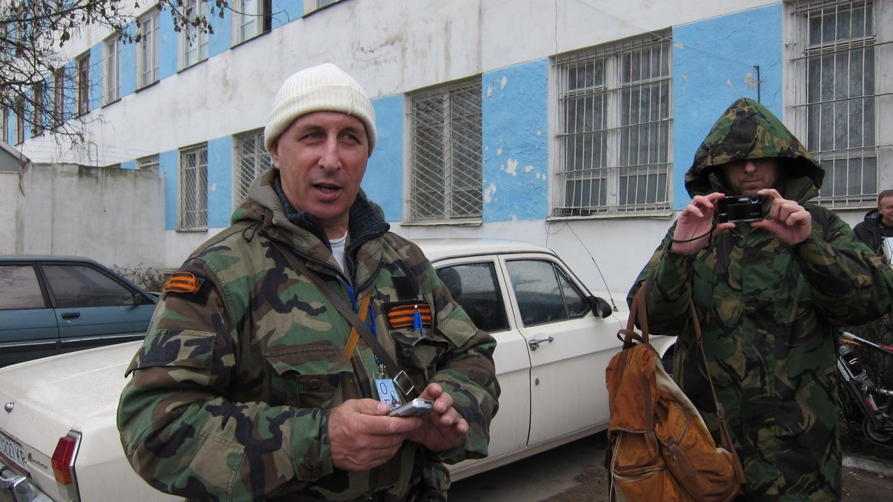 Pro-Russia men in fatigues stand guard outside Ukraine's naval headquarters in Sevastopol in Crimea.