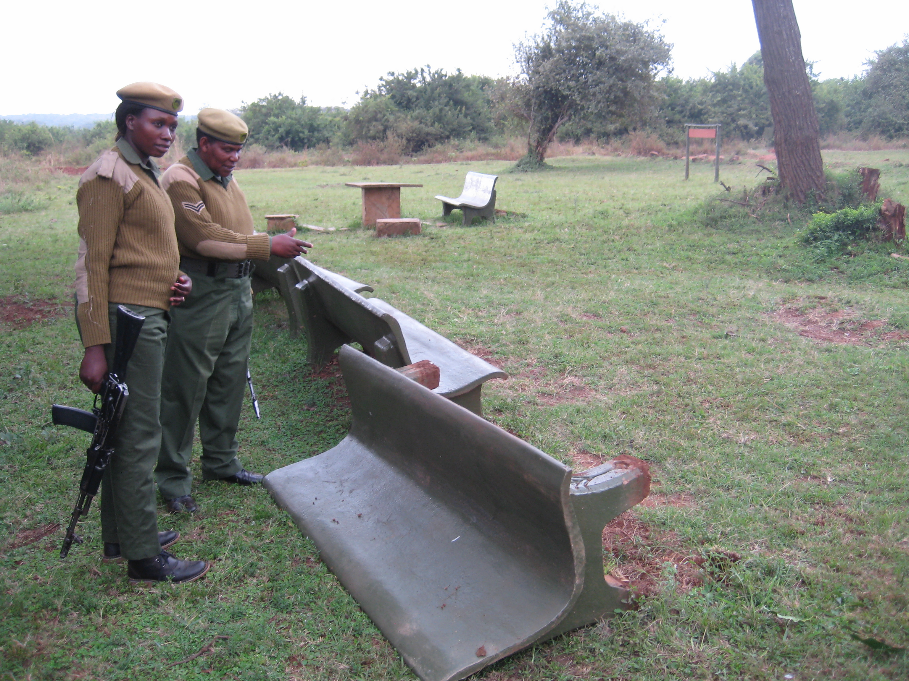 "Ranger Mildred Oduor (left) and Corporal Patricia Mututu inspect damage to a Nairobi National Park picnic area caused by a Cape buffalo.  ""Some may say [being a ranger] is a good job,"" says Oduor, ""but others may not like it because it has a lot of risk."""