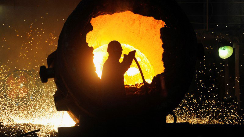 A man is silhouetted against a molten orange background.