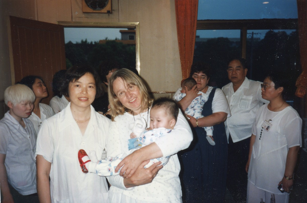 my daughter is my daughter due to s one child policy a s caregiver to my right placed chang yulu in my arms at changzhou s orphanage i placed a fluffy finger puppet in her arms so she d have a toy to