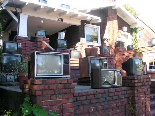 A house in Berkeley, Calif. decorated with old TV sets.
