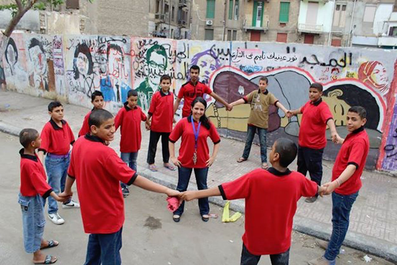 Morning circle time with Aya Hijazi and some of the children the group works with outside the Belady Foundation.