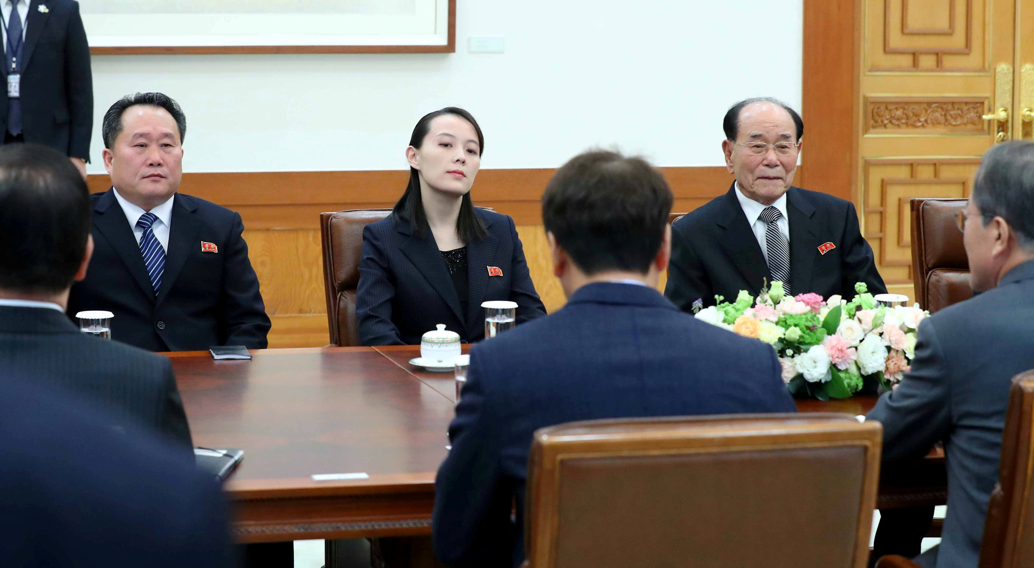 South Korean President Moon Jae-in talks with President of the Presidium of the Supreme People's Assembly of North Korea Kim Yong-nam and Kim Yo-jong, the sister of North Korea's leader Kim Jong-un.