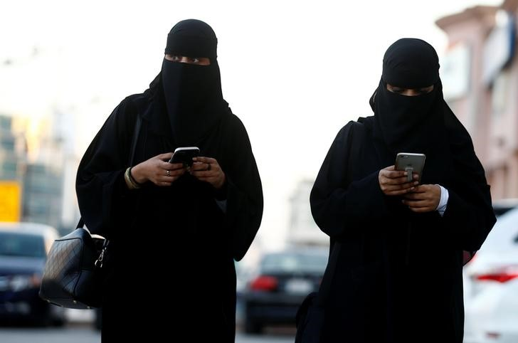Saudi women use their mobile phones in Riyadh, Saudi Arabia, January 2, 2017.