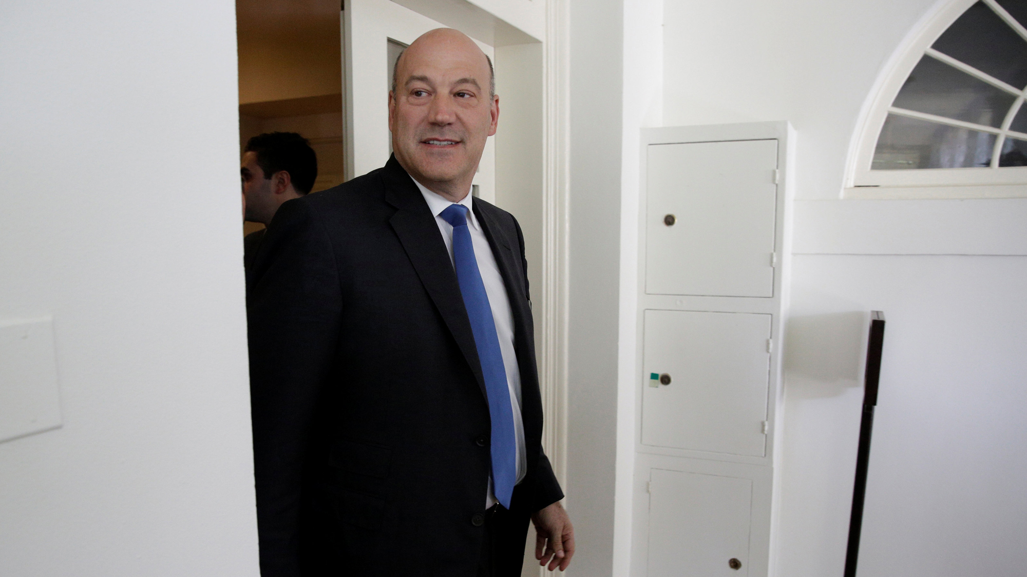 Gary Cohn is seen walking through a doorway at the White House in Washington DC.
