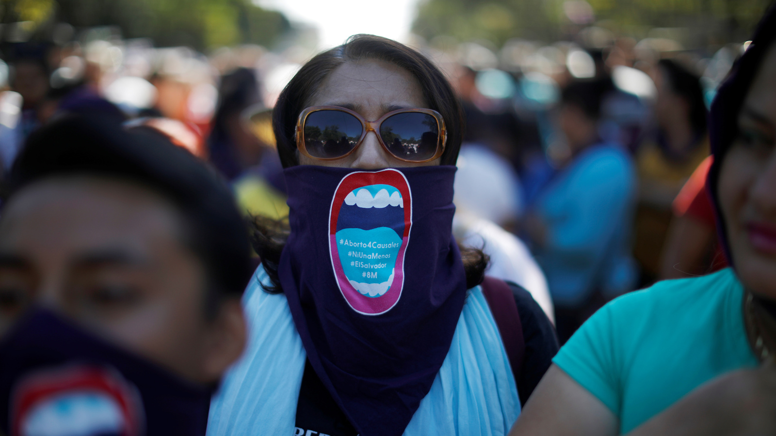 Activists participate in a march to call for an end to violence against women during International Women's Day in San Salvador, El Salvador, March 8, 2018.