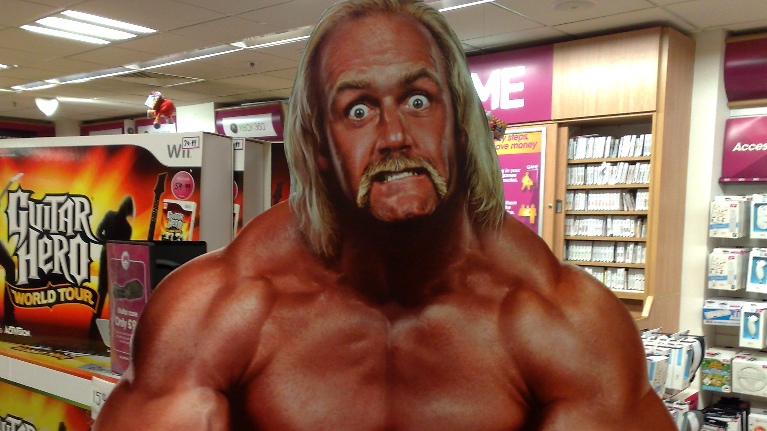 A poster of professional wrestler Hulk Hogan mugging for the camera.