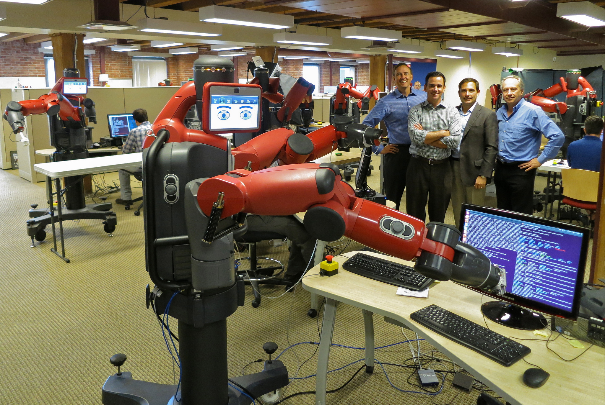 """Rethink Robotics' Baxter, which the company markets as a """"safe, flexible, affordable alternative to outsourced labor and fixed automation."""""""
