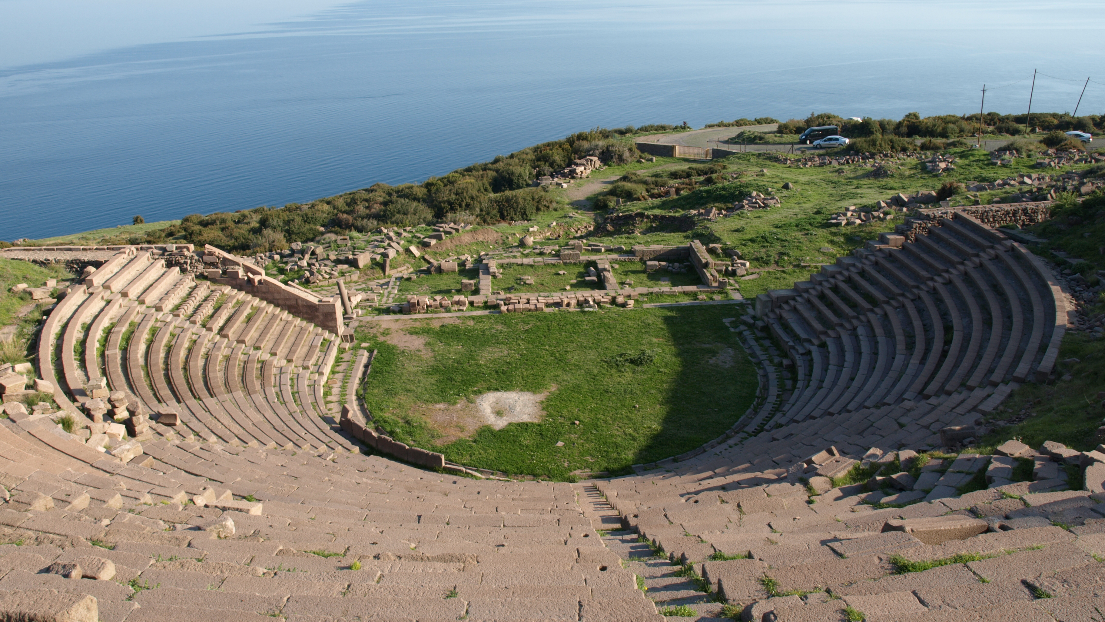 The ancient Theatre of Assos overlooking the Aegean Sea, with the nearby island of Lesbos on the horizon, at right.