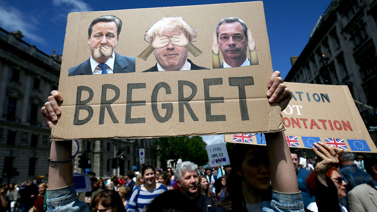 People hold banners during a March for Europe demonstration against Britain's decision to leave the European Union, in central London. Britain voted to leave the European Union in the EU Brexit referendum.