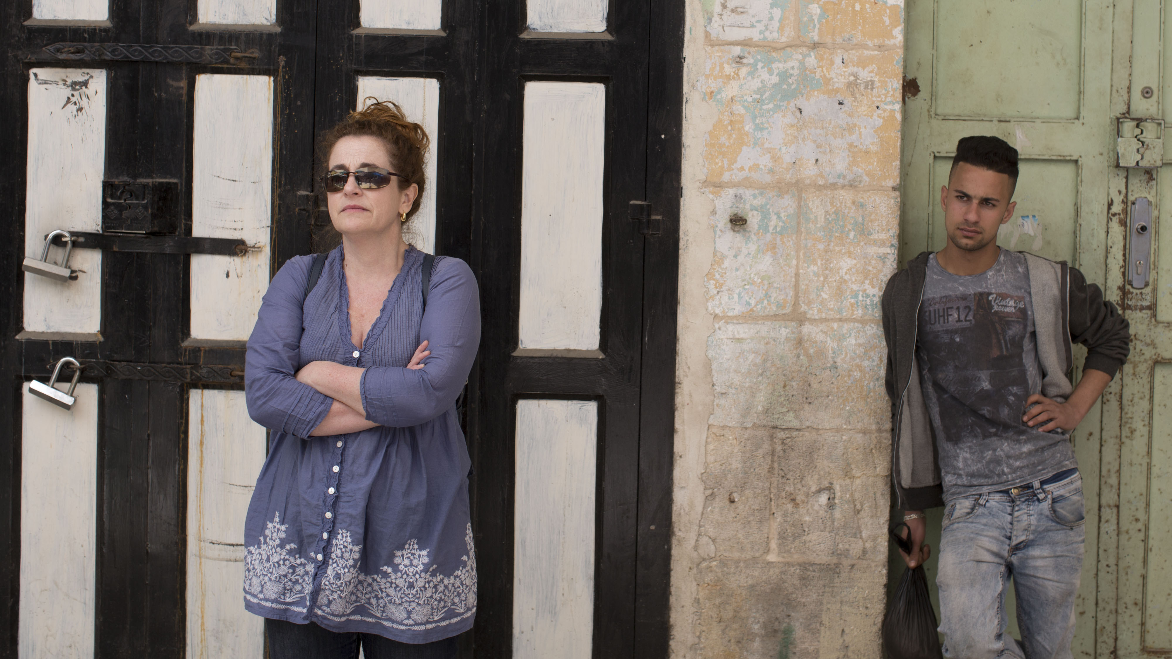 "Novelist Ayelet Waldman and a Palestinian man in Hebron. ""For most of my life, I loved Israel, I longed for Israel, I planned to live in Israel,"" she says."