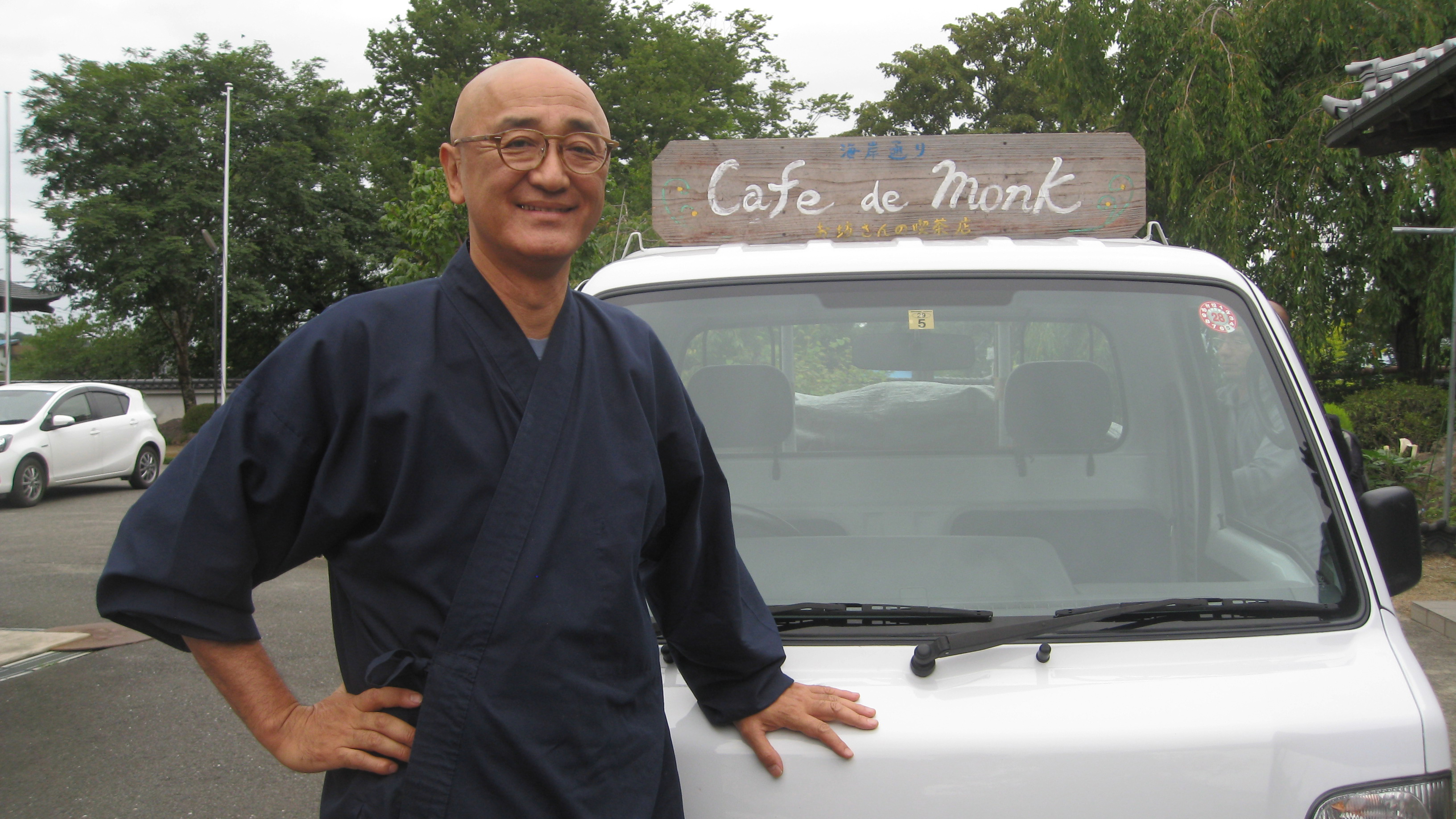 "Taio Kaneta with his signature ""Cafe de Monk"" truck that he uses for his pop-up cafes. As a Buddhist monk, Kaneta wanted to offer something special to those still reeling from the triple disaster of earthquake, tsunami and nuclear meltdown."