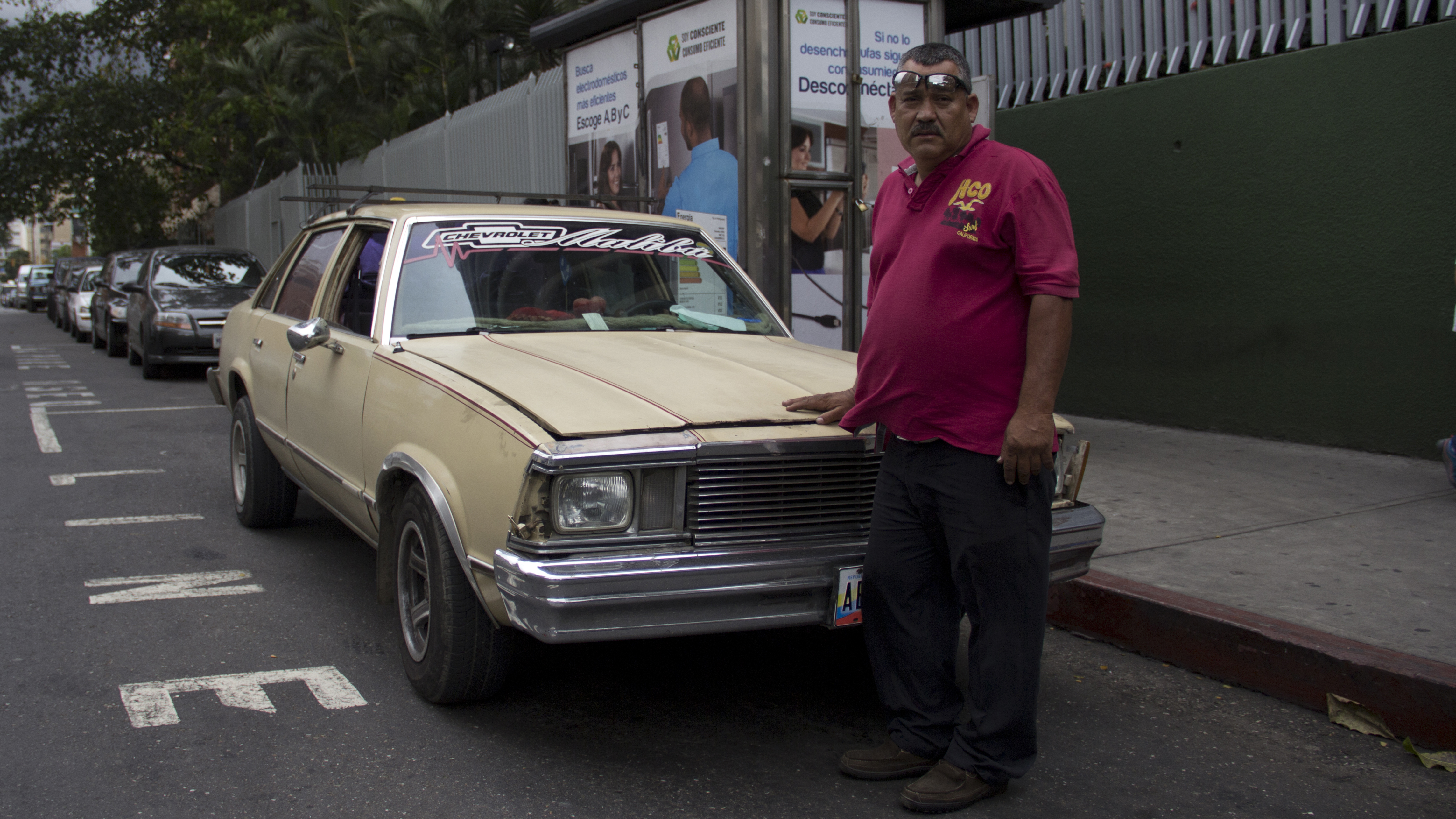 William Rivas drives his own Chevy Malibu as cab. Gas prices are so low in Venezuela that it costs him less than $1 to fill up the tank.