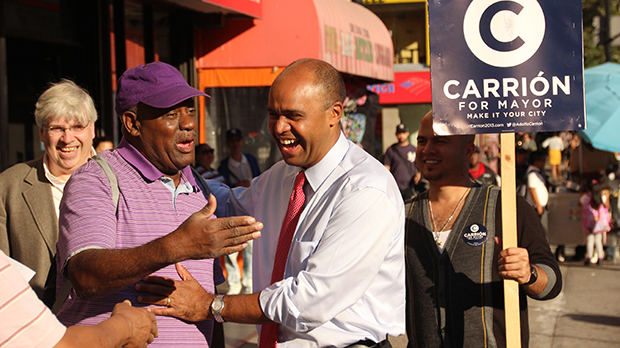 """Adolfo Carrión campaigns along 116th Street in """"El Barrio"""" in East Harlem. Carrión, a former Bronx Borough President and member of the Obama administration, is running for New York City mayor on the Independence Party ticket."""