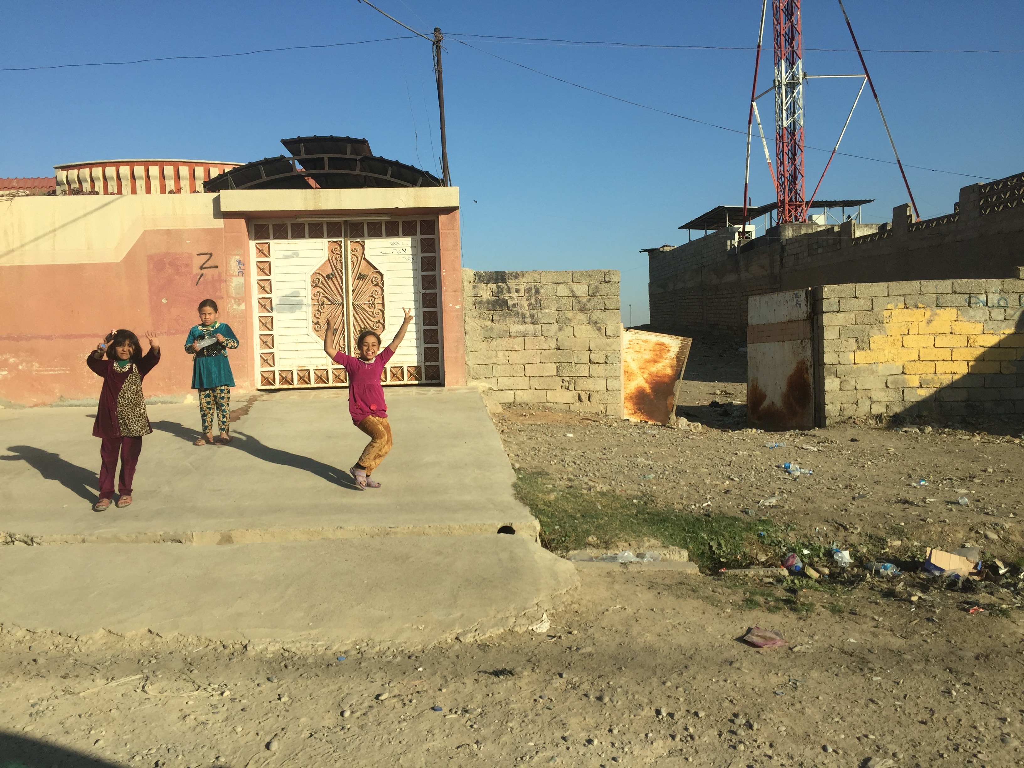 A group of kids play in the Mosul