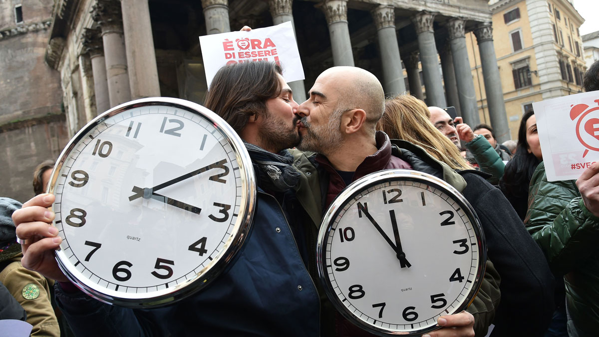 A couple kiss in front of the Pantheon during a demonstration of supporters of same-sex civil union in Rome.
