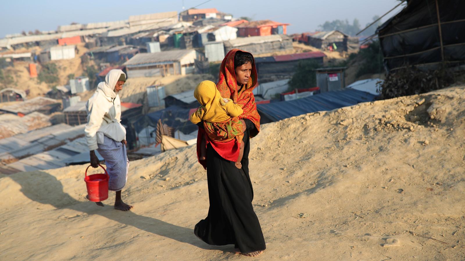 Rohingya refugees walk at Jamtoli camp in the morning in Cox's Bazar, Bangladesh, Jan. 22, 2018.