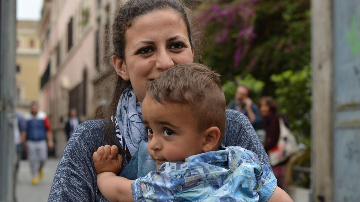 The youngest Syrian refugee aboard the papal plane was 2-year-old Riyad, carried here by his mother Nour.