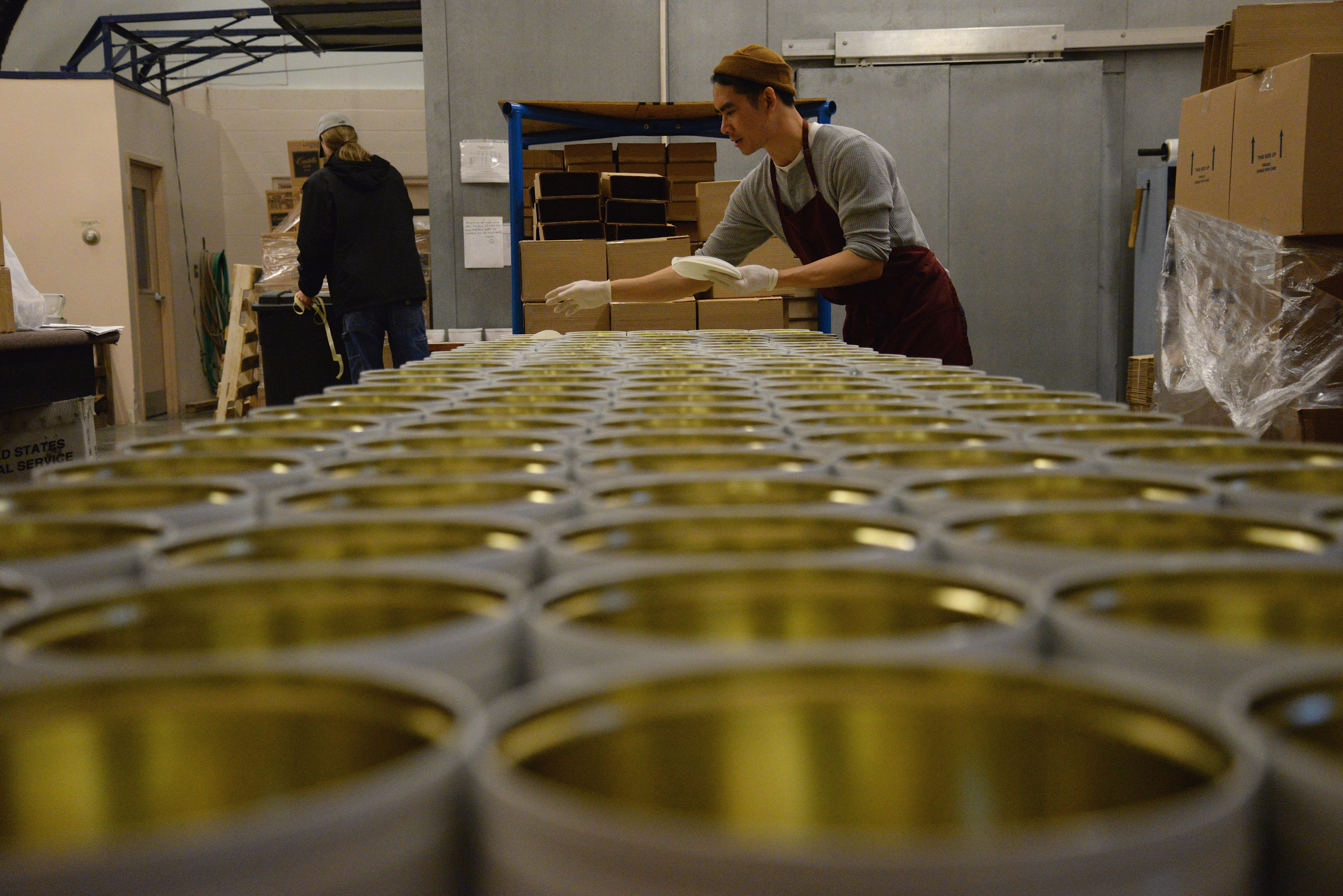 Man looking across rows of tins