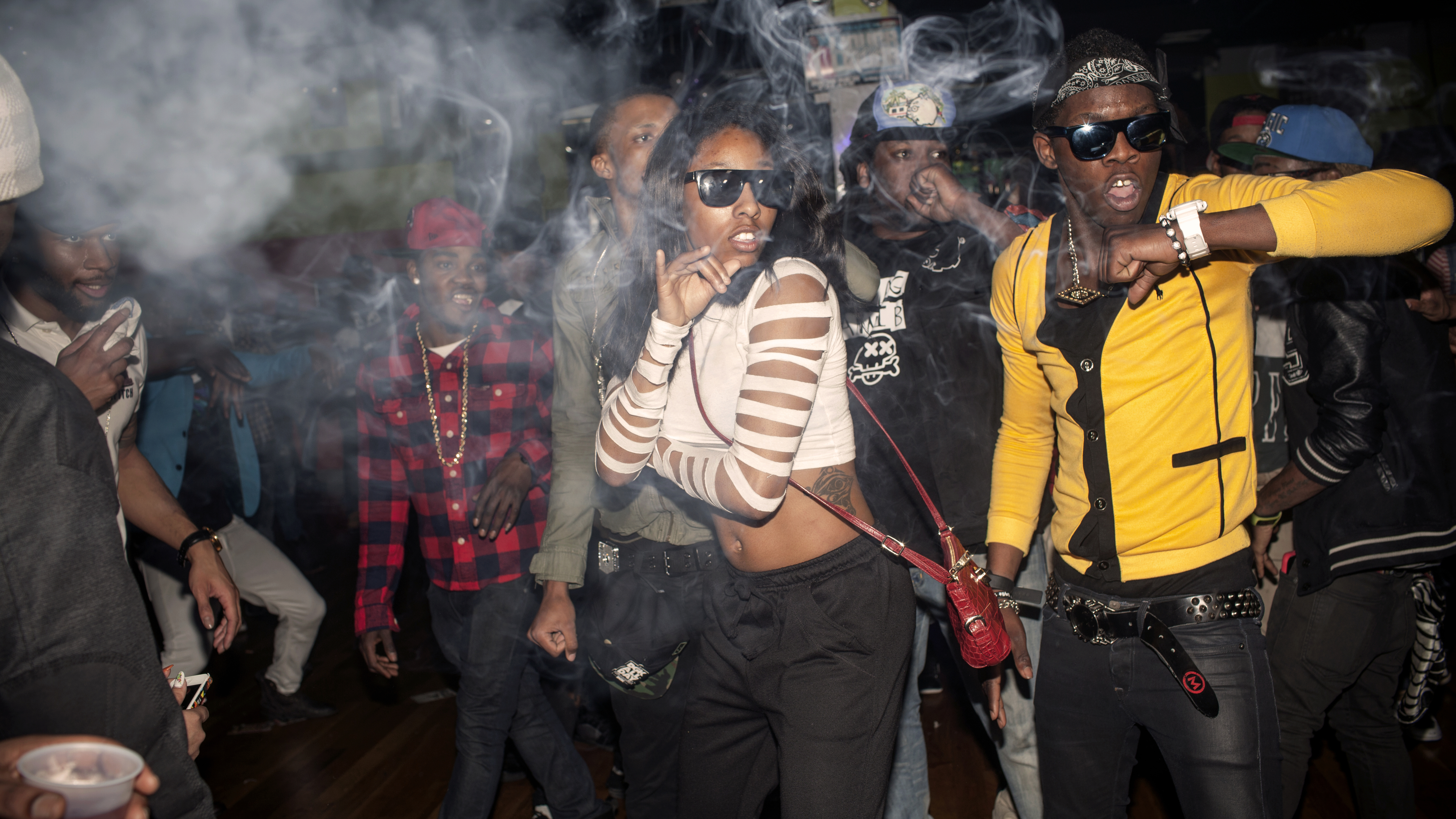 The Flavor Essence dance team moves through its choreography in unison as smoke clouds the air in a nightclub around 3am on a Thursday night. Videographers often attend the parties to make video of the dancers, which will be published on the internet on v