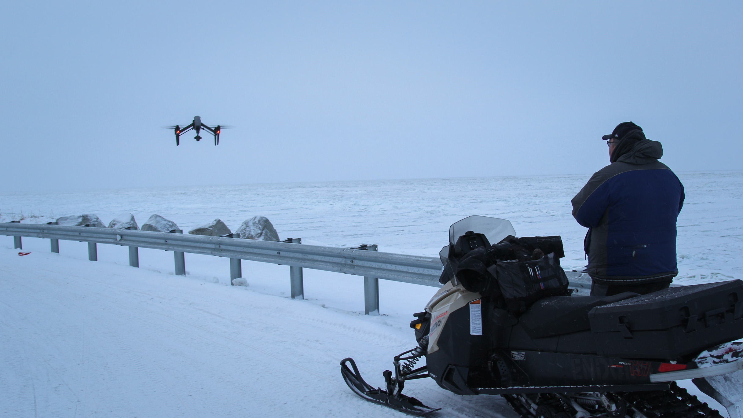 Subsistence hunter Dennis Davis sends his drone out over the ice on the Chukchi Sea in Shishmaref in far-western Alaska. Warming winters have made the sea ice here more dangerous to navigate in search of seals and walruses, but drones can help map the bes