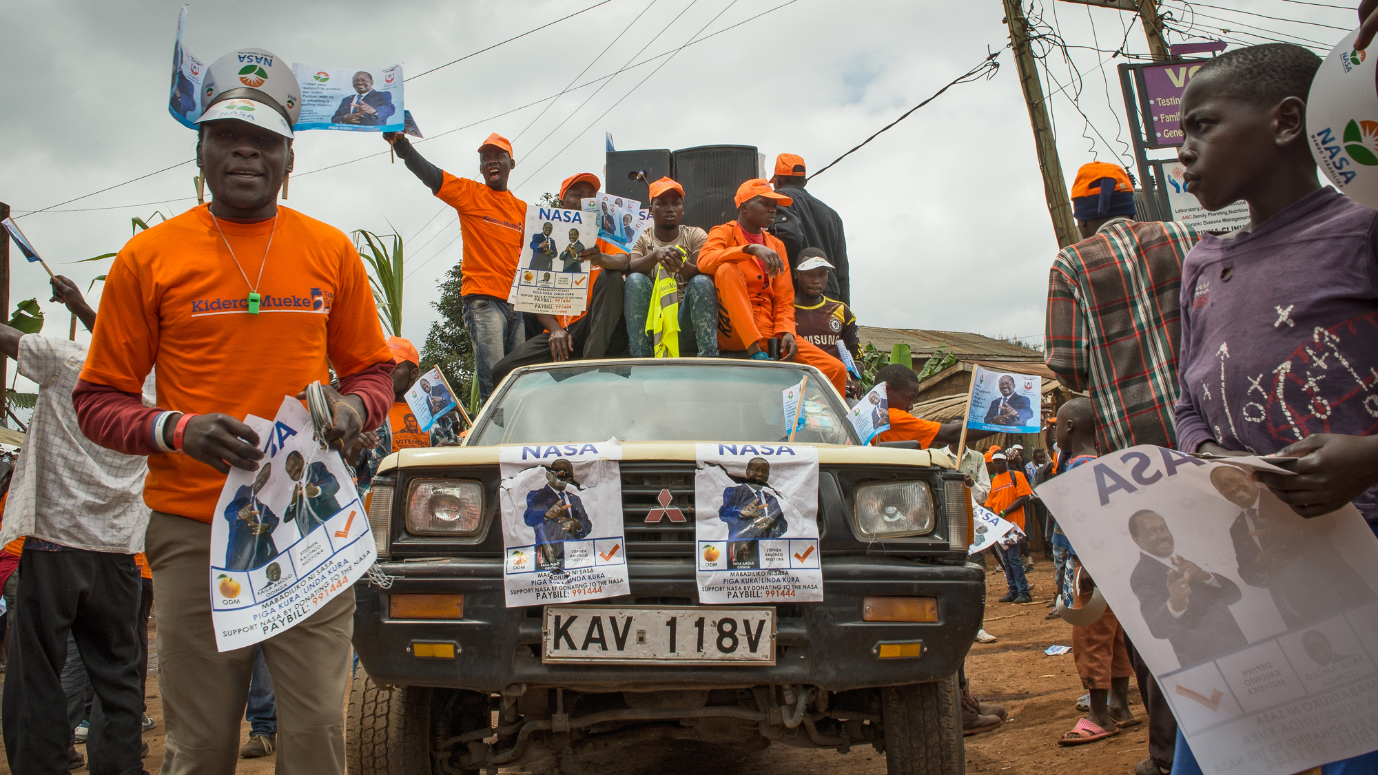 Opposition party members chant campaign slogans in support of National Super Alliance Presidential candidate, Raila Odinga in Kibera, Nairobi. Kenya's upcoming elections pinned current President Uhuru Kenyatta against his long-time rival Odinga, who has c