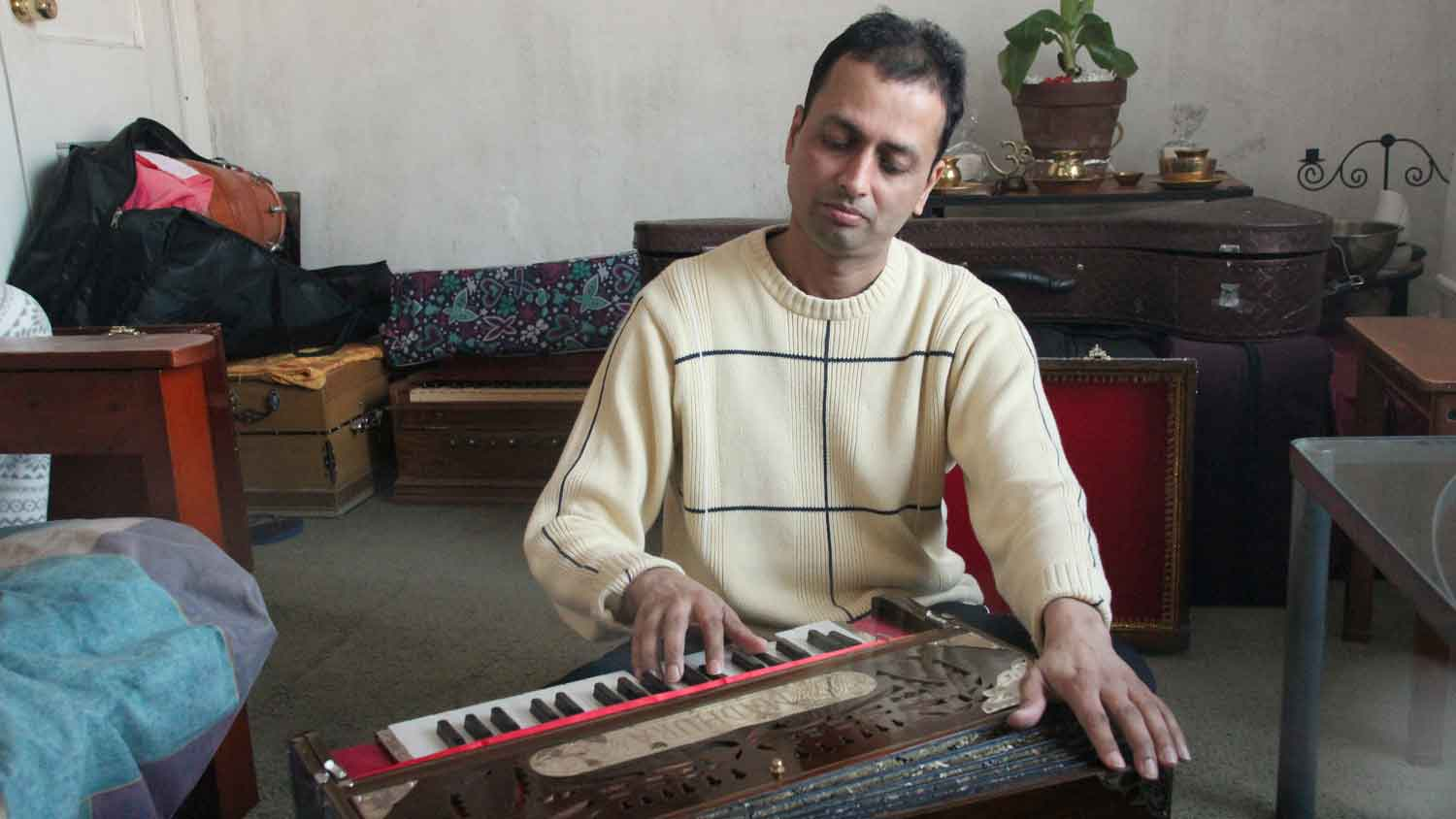 """""""I think I'm blessed in tuning harmoniums,"""" says Mindra Sahadeo, who is from Guyana but now lives in New York City. """"I find joy, actually, in fixing them."""""""