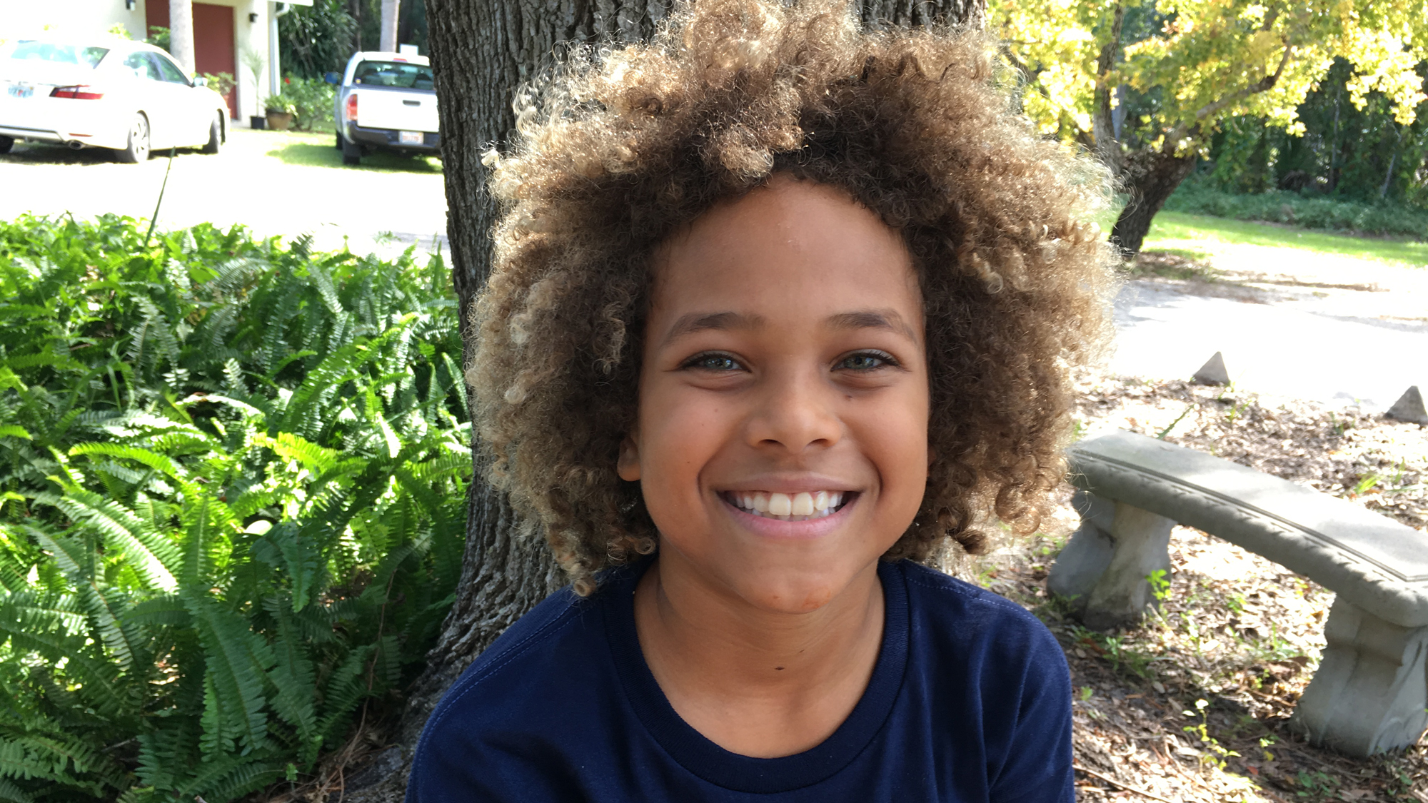 A portrait of 10-year-old Levi Draheim with brown-blonde curly hair.