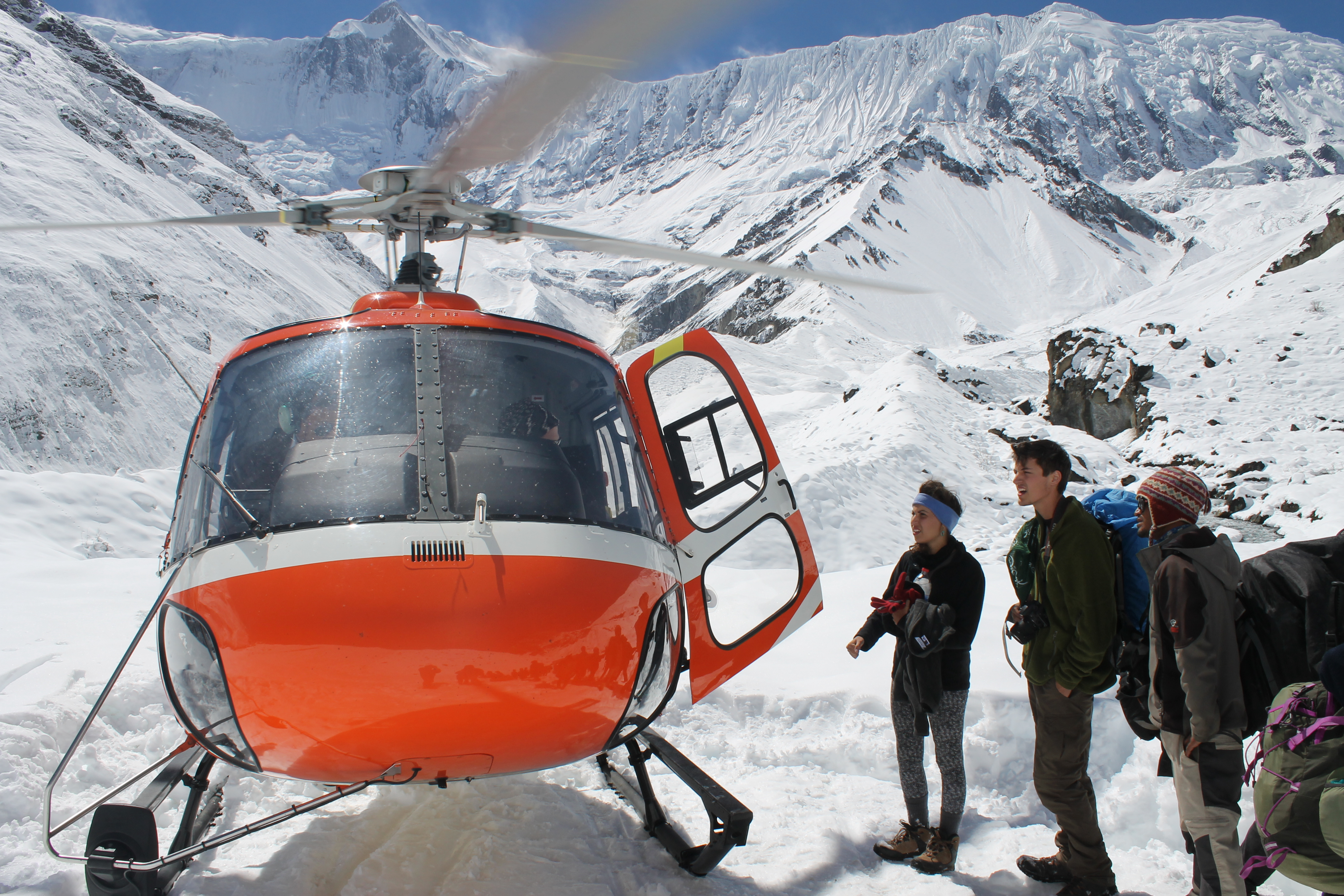 A helicopter rescues stranded trekkers along the Annapurna Circuit trail in Nepal on October 16, 2014.