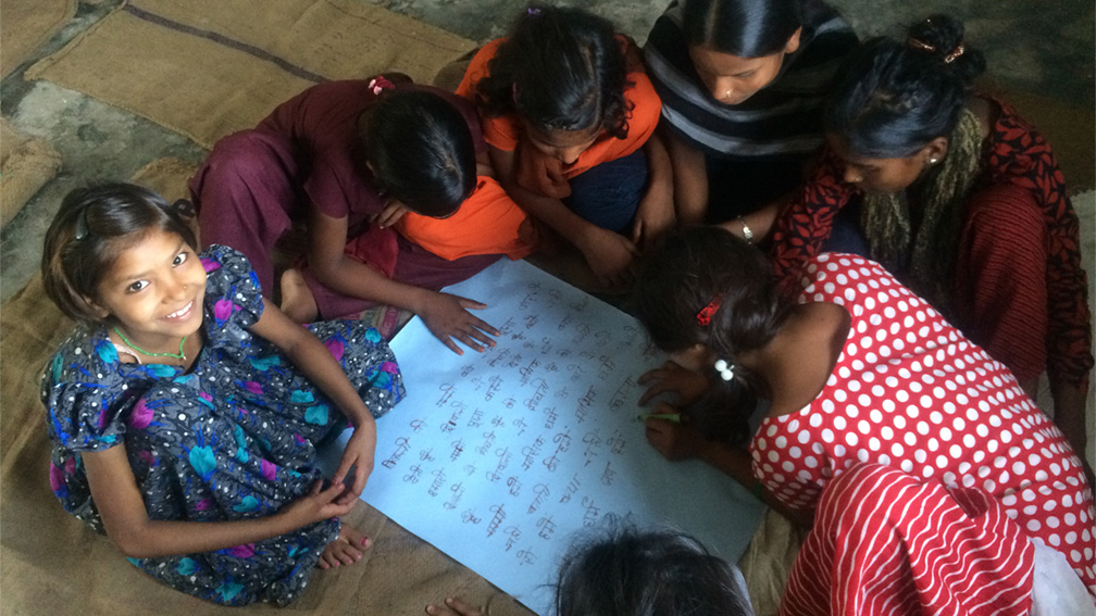 A group of young girls makes a list of questions on menstruation after watching a film about the issue.