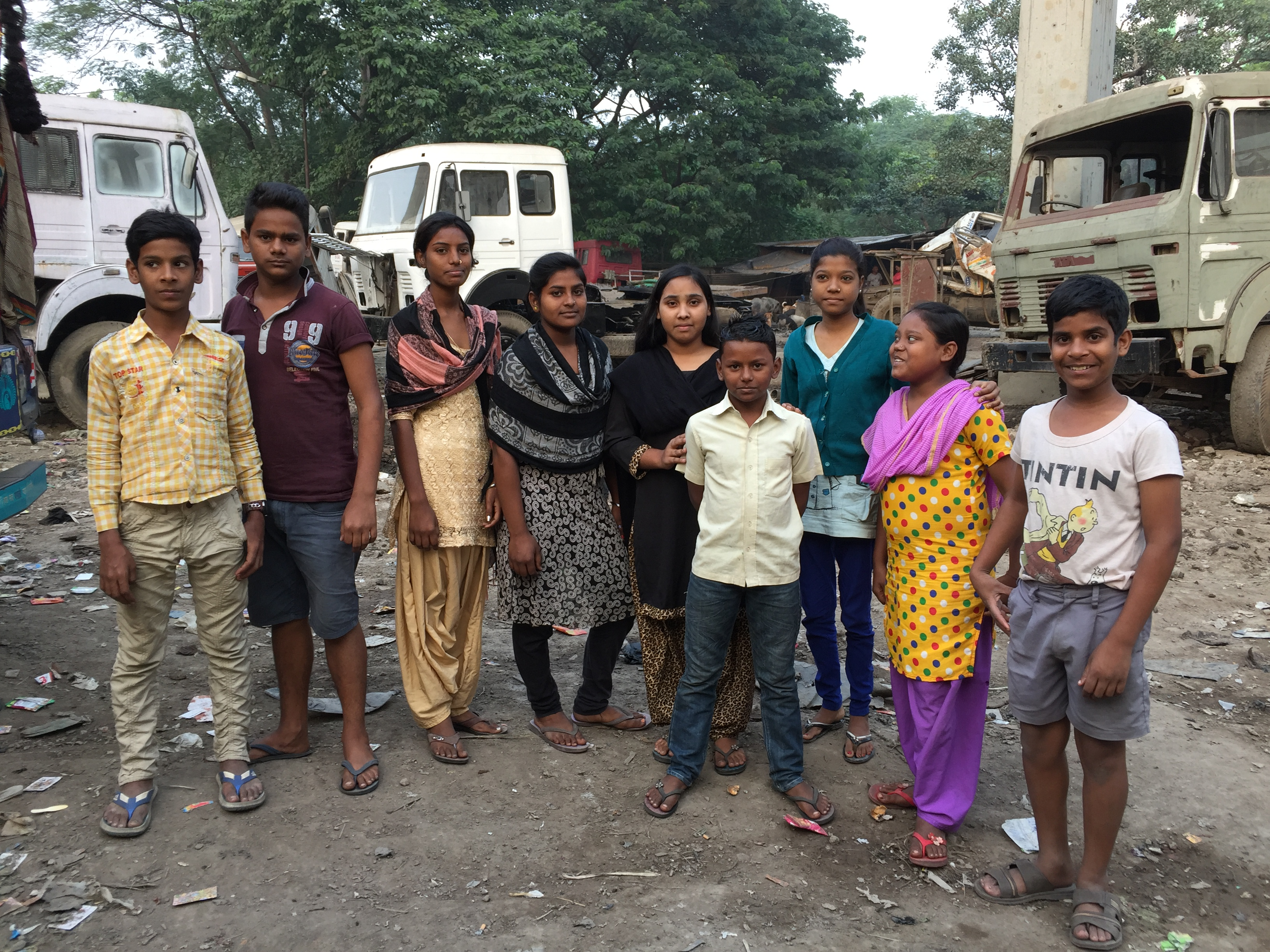 A group of children from the Shaktimaan group pose together in a slum in Kolkata, India, convincing child dropouts to go back to school.