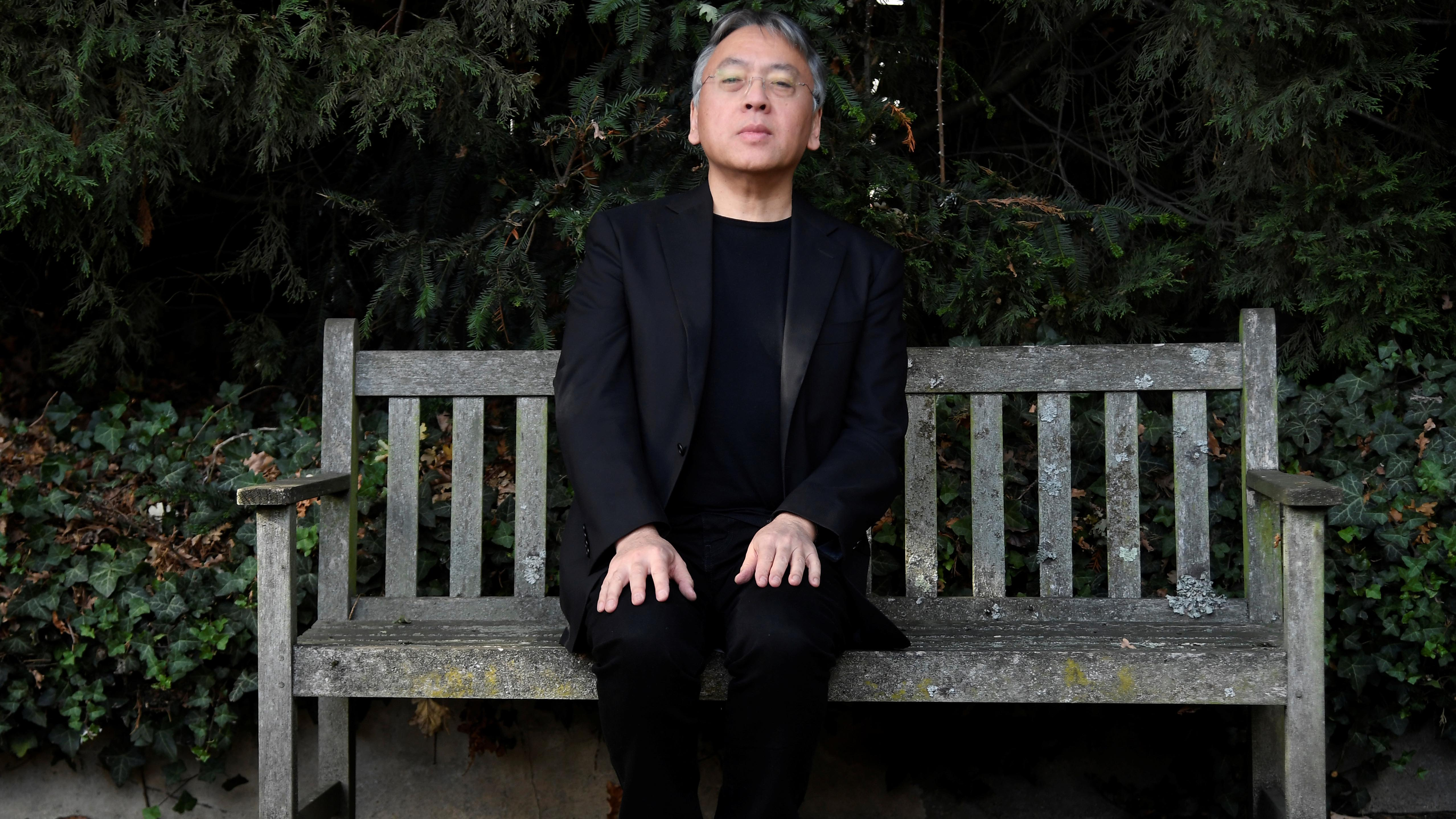 Author Kazuo Ishiguro poses for the media outside his home, following the announcement that he has won the Nobel Prize for Literature, in London, Britain, on Oct. 5, 2017.