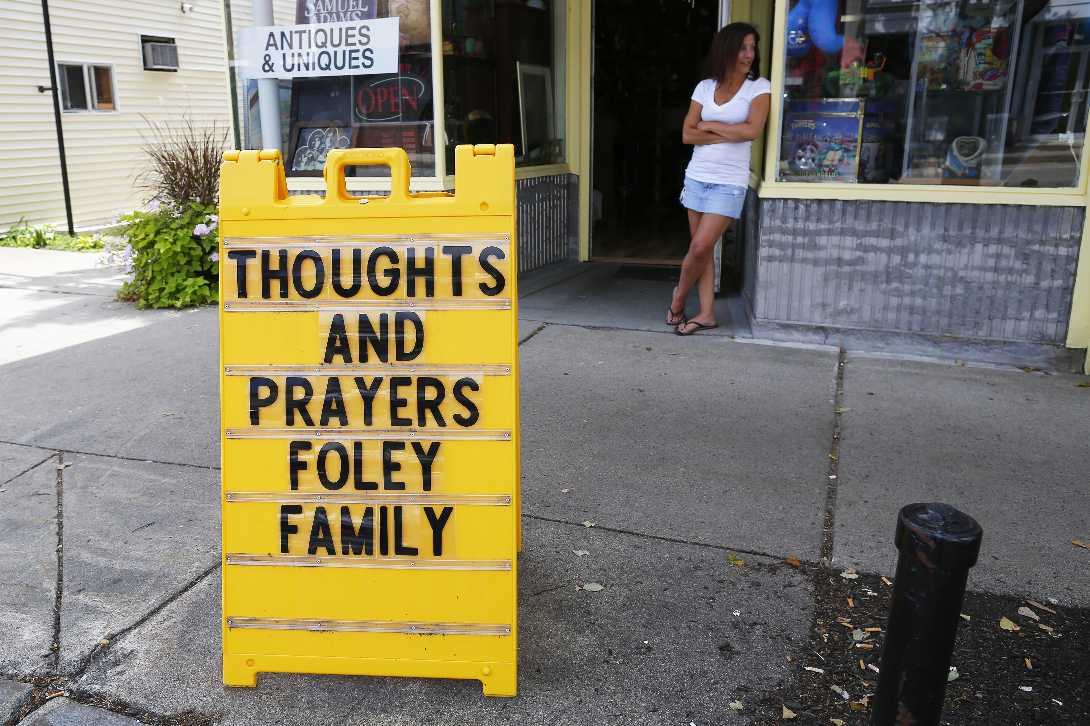 A sign outside a shop remembers James Foley in his hometown of Rochester, New Hampshire. Islamic State militants killed the journalist in a brutal videotaped beheading in revenge for US air strikes in Iraq.