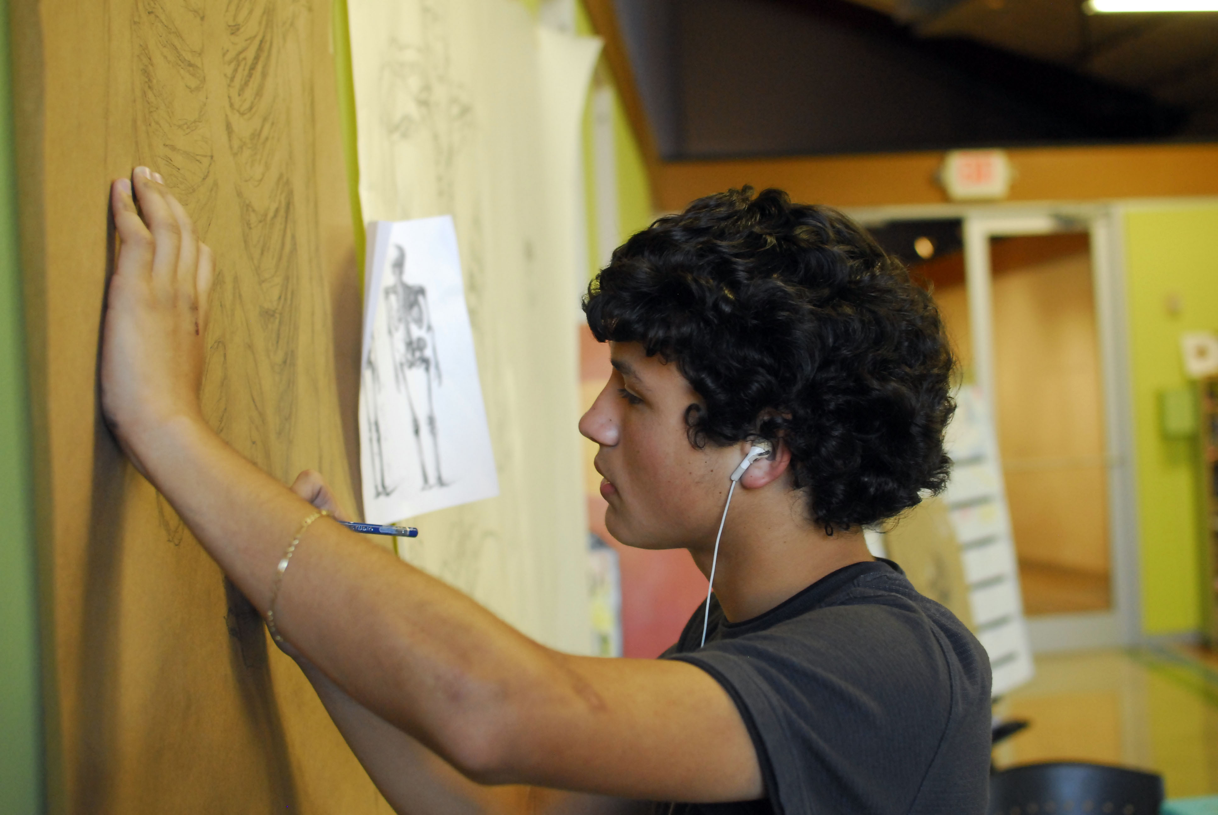Young man making art on a wall