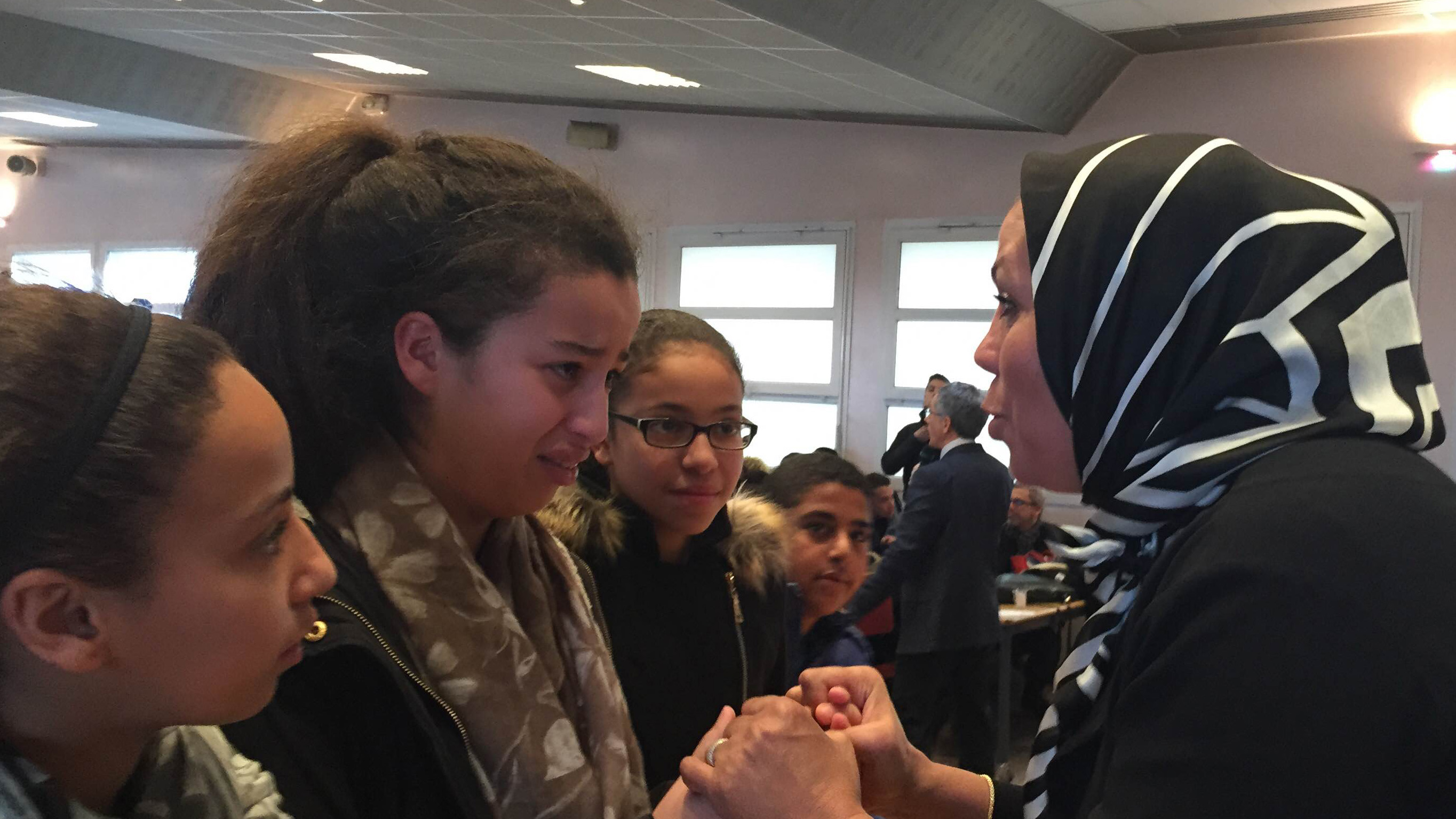 Latifa bin Ziaten (r) speaks with students about her son, Imad, who was murdered by Islamic extremist Mohamed Merah. At the end of her talk, students hug her. One girl says Latifah reminds her of her own mother.