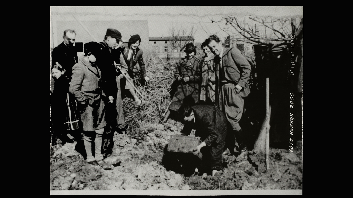 Excavating Henryk Ross's buried box of negatives and documents in the ghetto, 1945. Henryk Ross (Polish, 1910–1991)