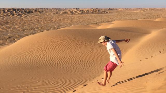 Donatella Lorch's son running the dunes just before sunset.