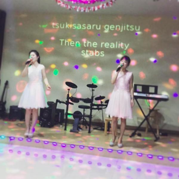 Waitresses at a North Korean restaurant in Bangkok croon along to karaoke tracks.