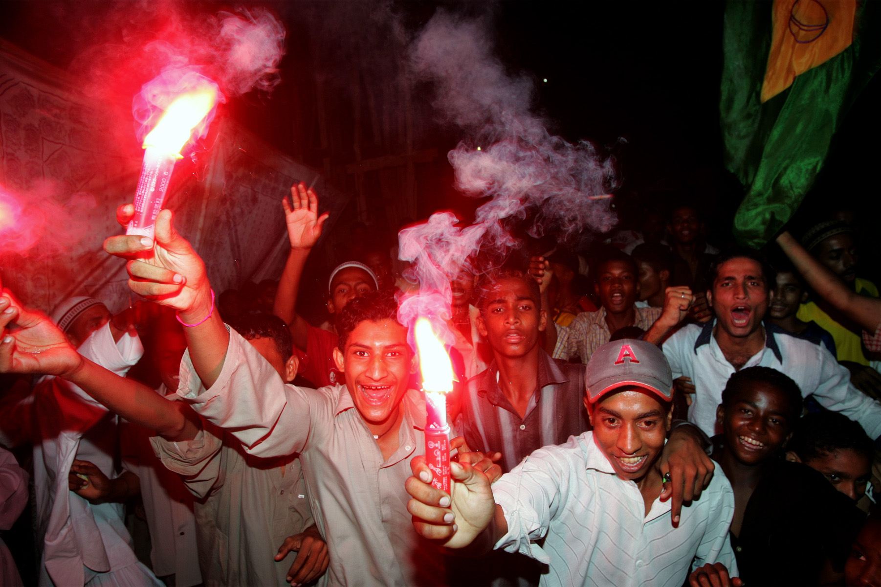 Pakistani soccer fans celebrate a Brazil victory in Lyari, one of the oldest and most densely populated parts of the city, plagued by street crime, drugs, and unemployment.