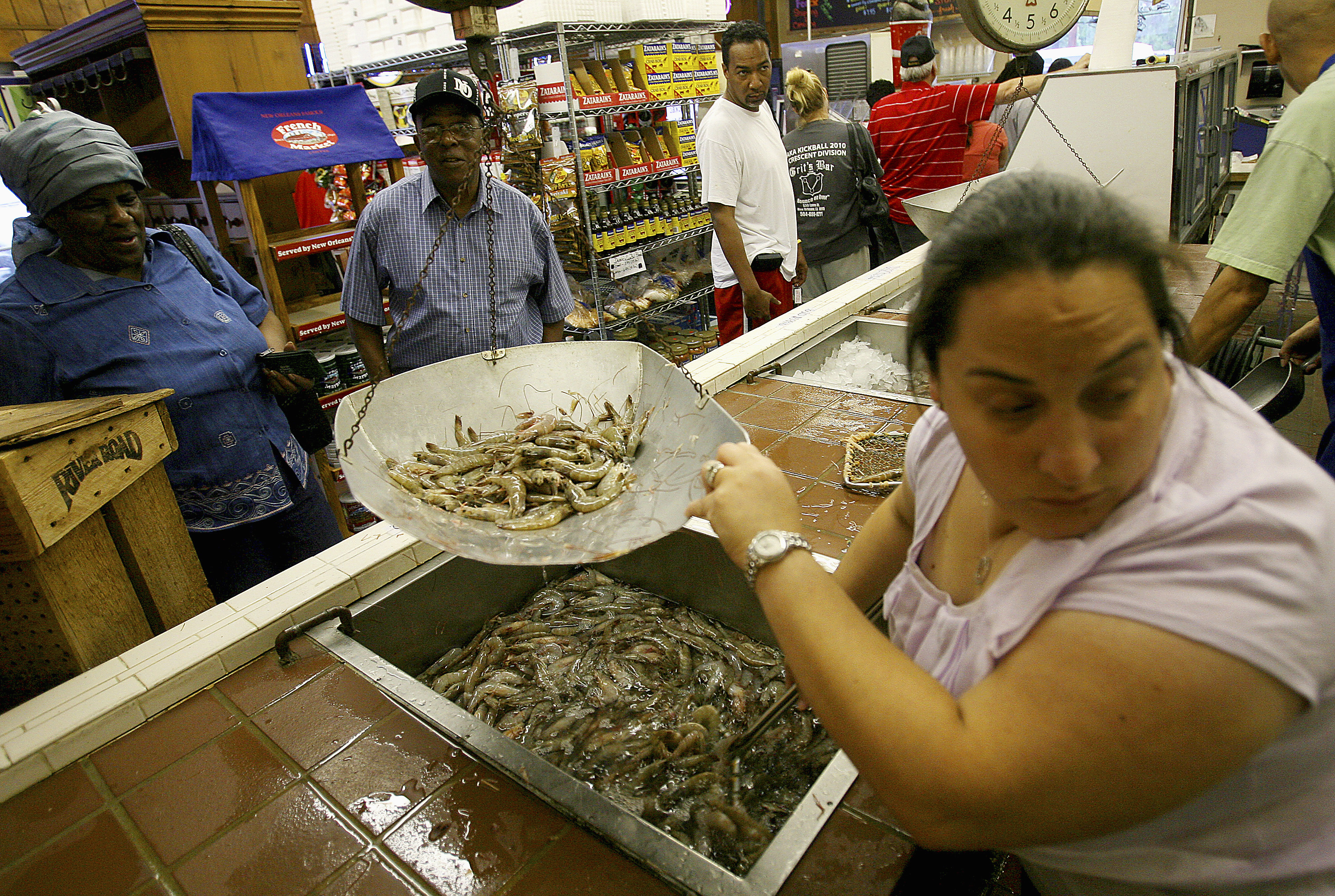 Chandra Chifici at Deanie's Seafood weighs shrimp for customers in Metairie, Louisiana, in 2010.