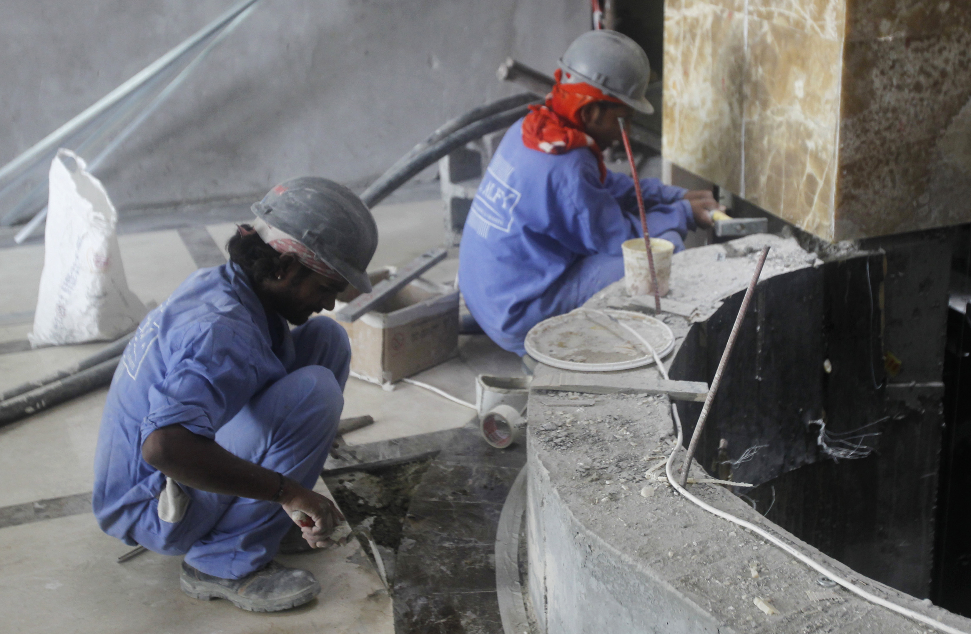 Labourers work at a construction site in Doha June 18, 2012.