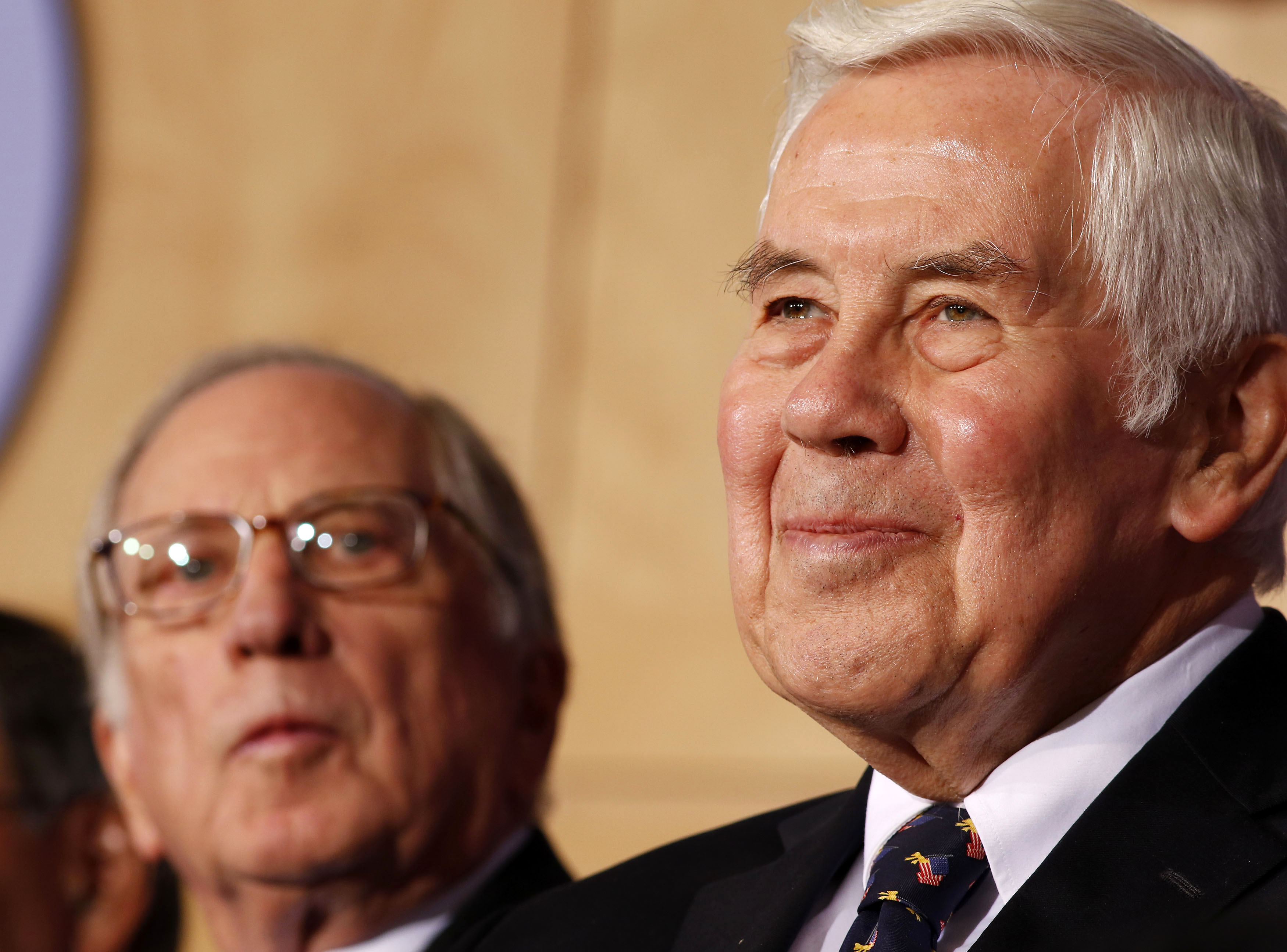U.S. Senator Richard Lugar (R) joins Co-chairman and chief executive officer of the Nuclear Threat Initiative, Sam Nunn at the National Defense University in Washington, on December 3, 2012.