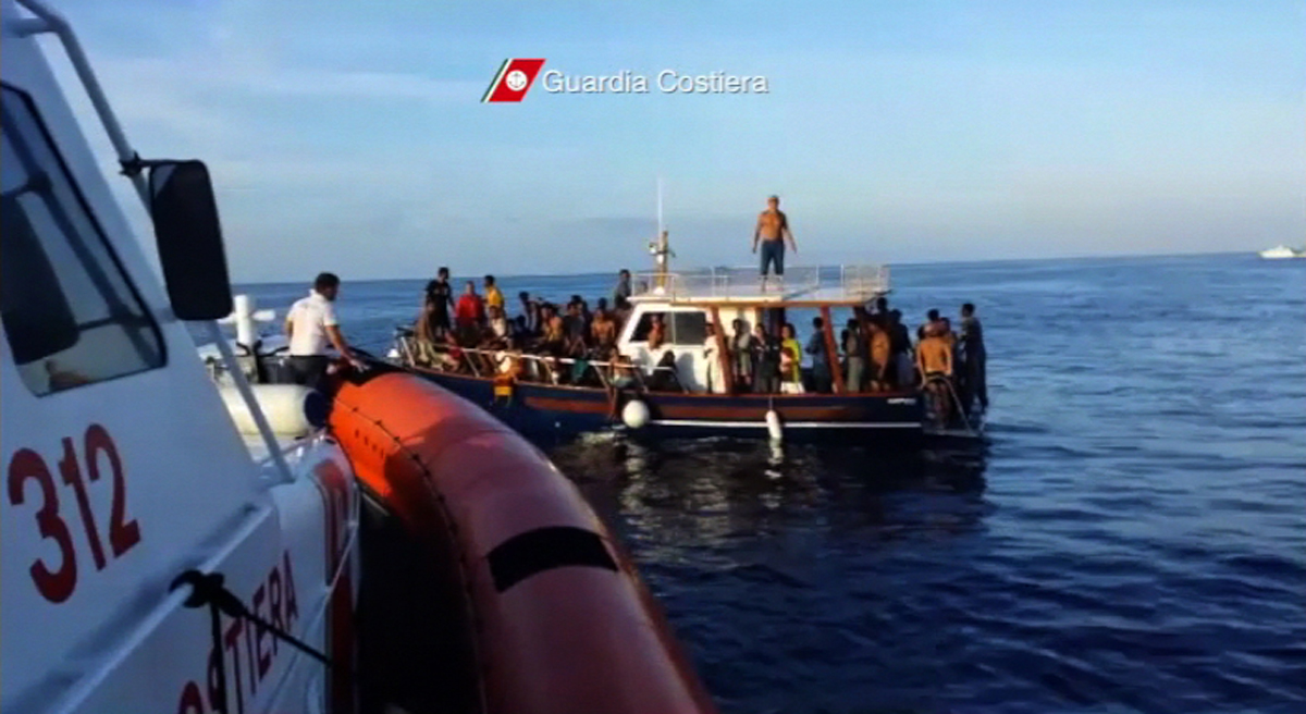 Migrants rescued by Italian Coast Guard