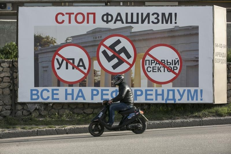 "A billboard urged people to vote in Crimea's referendum. The poster reads, ""Stop fascists everyone, come to the referendum"" ."