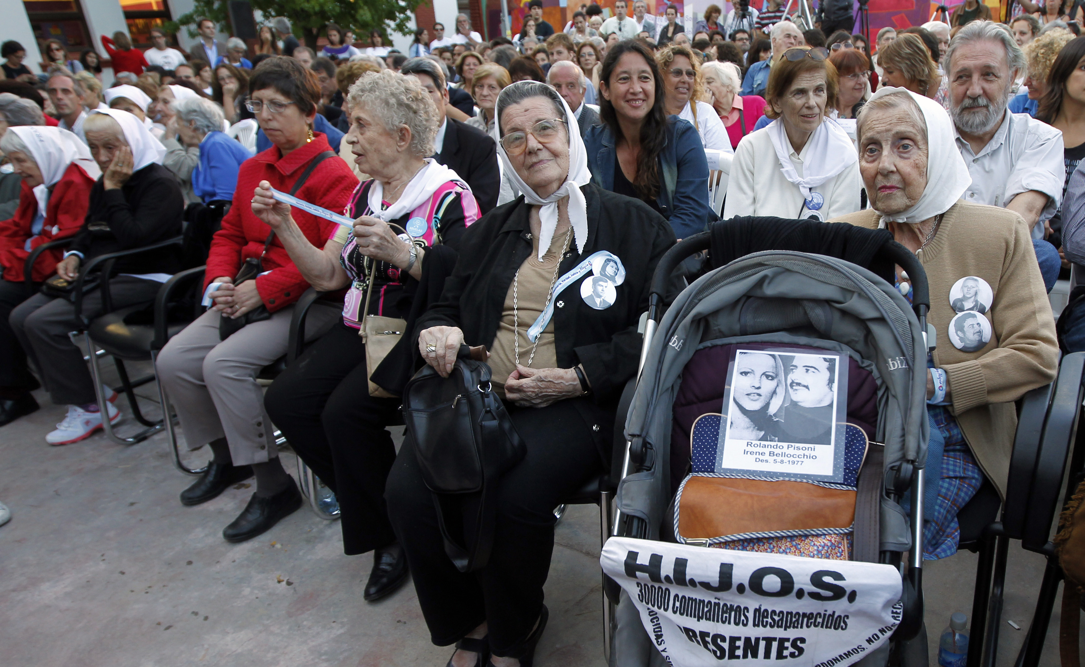Aurora Zucco de Bellocchio, a member of human rights organization Madres de Plaza de Mayo (Mothers of Plaza de Mayo), sits behind a pram with a picture of her daughter Irene Bellocchio and her partner Rolando Pisoni, who both disappeared in 1977, during t