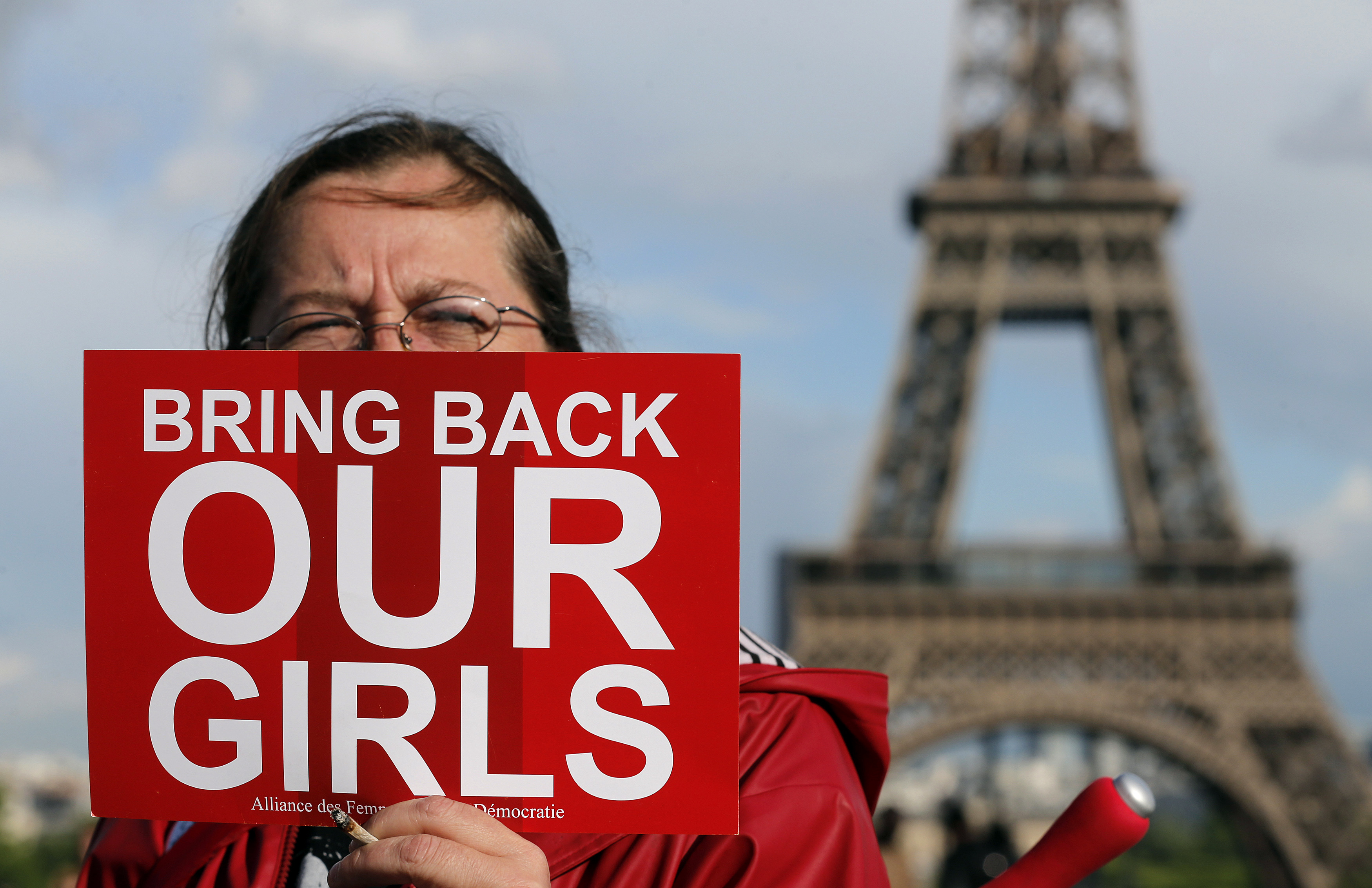 A protester at Trocadero Square near the Eiffel Tower in Paris demonstrates against  the kidnapping of school girls in Nigeria.